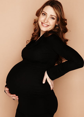 Pregnant woman wearing Maternity Top