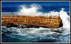 Sea Wall Waves, La Jolla , California (moonjazz) Tags: california travel blue white storm wet water stone wall coast slam waves power pacific sandiego action crash cove over lajolla seawall shelter bang liquid protect