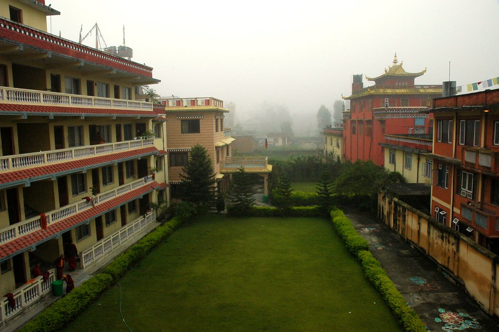 Cool mountain mists, monks quarters on the left, behind which is HE Dezhung Rinpoche's house,  view from the 3rd floor, Tharlam Monastery of Tibetan Buddhism, Boudha, Kathmandu, Nepal