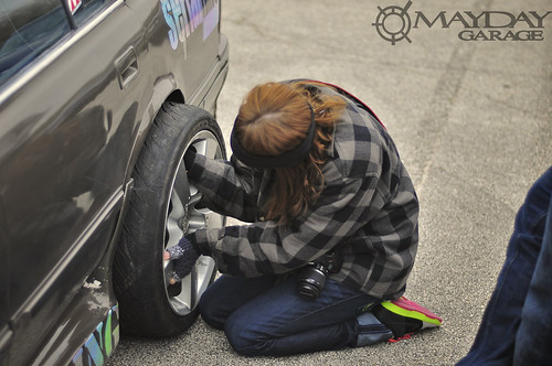 Yes! A girl changing out wheels and tires on a drift car! I HAD to take a pic!