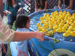 Aki scooping ducks at Carnival