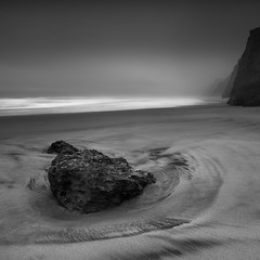 Lucidity (maxxsmart) Tags: ocean california winter bw seascape beach water rock fog contrast canon sand cookie thankyou pacific 9 lee change footsteps 2009 sanmateocounty pescaderostatebeach gnd ef2470f28l crazybeautiful ndgrad 5dmarkii imlaggin paterncliffs