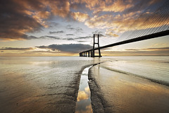 "Morning ""reflections"" (CResende) Tags: bridge sun color portugal clouds sunrise river landscape nikon expo lisboa nuvens tejo nds pontevascodagama d300 pvg riotejo sigma1020 parqueexpo photowalker hitechfilters cresende gettyimagesspainq1"