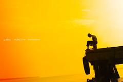This is Africa (Weapon X) Tags: africa boy sunset shadow red orange sol look silhouette de atardecer muelle spring fisherman rojo think sombra gambia chico silueta puesta mirada naranja pensar pescador mywinners superaplus aplusphoto