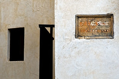 the walls of Malaga (robinparmar) Tags: door old shadow abstract texture window weather sign wall photo spain paint pentax plaster minimal espana weathered peel andalusia limited malaga fa 77mm fa77mm fa77 k20d justpentax