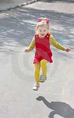 Jumping girl (Kruchancova's life) Tags: park red summer people motion color cute girl smile childhood playground sport fun concrete happy person jumping child drawing small leg joy cement daughter happiness games number growth human leisure preschool hopscotch crayon cheerful asphalt playful