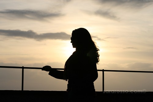 Woman's silhouette at sunset, Portofino, Italian Riviera, Italy