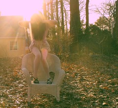 the dog days are over (katieohh) Tags: sunset sunlight selfportrait outside outfit chair backyard sittingdown longhair explore anonymous sunflare wickerchair lookbook coveringface katieohman
