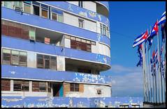 Havana blues (steverichard) Tags: travel blue building outside island photography decay vibrant flag havana cuba malecon caribbean flagpole peelingpaint cuban socialism kuba apartmentblock lahabana cubano fromthestreets steverichard