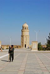 TKM-Merv-0809-057-v1 (anthonyasael) Tags: road street sky brown sun man color building men brick history monument lamp vertical wall architecture standing religious 1 stand sticks streetlight asia view adult mud minaret islam religion central silk mosque front tourist structure historic full divine spire holy mature dome only historical stick caravan spirituality visitors spiritual length domes visitor adults travelers built islamic baked traveler merv mulu turkmenistan marw