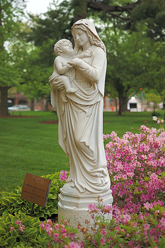 Statue of the Blessed Virgin Mary with the Christ Child, in the garden of Saint Peter Roman Catholic Church, in Kirkwood, Missouri, USA