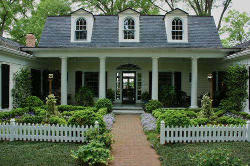 White picket fence with parterres in front garden a photo on