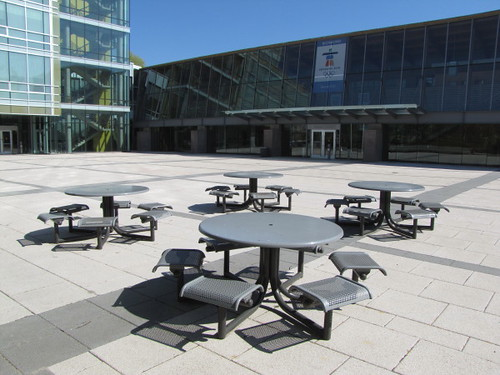 Metal chairs in outdoor plaza at Richmond City Hall