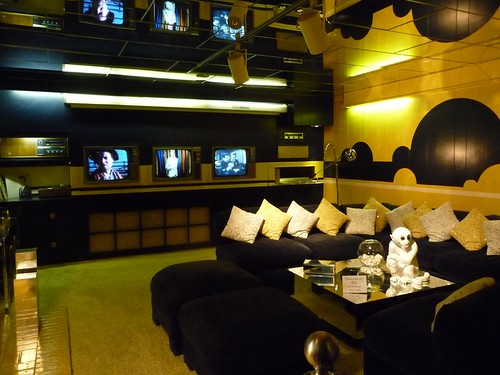 media room with 3 tvs.