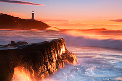 Beach (-yury-) Tags: ocean light sea cloud lighthouse seascape beach water sunrise landscape rocks wave australia nsw soldiers centralcoast norahhead soldiersbeach abigfave ultimateshot