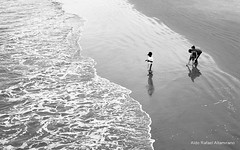 Kids (Rafakoy) Tags: ocean park shadow sea summer bw white ny newyork black hot film beach water brooklyn 35mm canon coneyisland 50mm photo sand warm waves ae1 f14 perspective wave atlantic pointofview negative program epson v600 kodakbw400cn perfection fd ae1program c41 fd50mmf14 realphotography epsonv600 epsonperfectionv600 aldorafaelaltamirano rafaelaltamirano aldoraltamirano