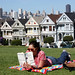 Casi reading Delivering Happiness in Alamo Square