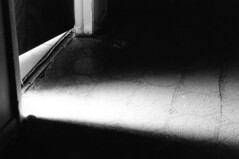 Light Leak (Ryan.Berry) Tags: lighting door light contrast dark floor minolta entrance crack doorway exit leak
