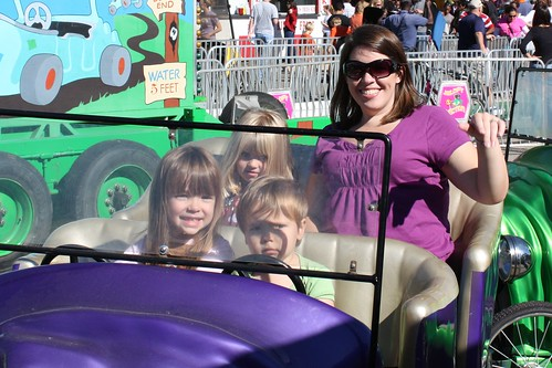 "Elizabeth, Austin, Catie & me on the ""Jalopy Junction"" ride at the fair"
