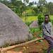 Boys sit near their traditional house, Gamo Gofa Zone, Ganta, Ethiopia