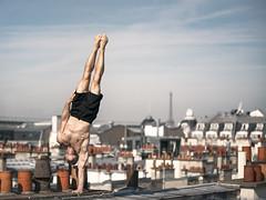 (dimitryroulland) Tags: nikon d600 70200 tamron city roofs paris france toureiffel eiffel performer art handstand balance sport onearm yoga natural light