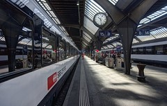 Nächster Halt: Zürich Hauptbahnhof (PeterThoeny) Tags: zurich zürich switzerland station railway railwaystation hauptbahnhof bahnhof track clock symmetry onepointsymmetry 3xp raw nex6 photomatix selp1650 hdr qualityhdr qualityhdrphotography fav100 fav200