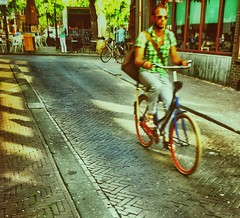 Sunny morning commuter (Ruud Otter) Tags: morning sun street iphone abstract urban fiets bike