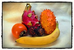 exotic composition :) (green_lover (your COMMENTS are welcome!)) Tags: fruits exotic pitahaya sharon banana rambutan kiwano composition colours home food explorewinnersoftheworld frame explore lookingcloseonfriday stilllife