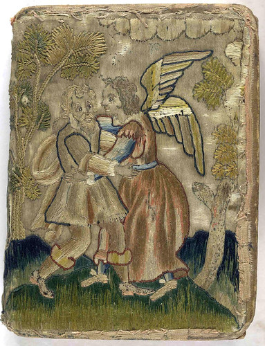 17th century embroidered satin book with pictorial angel and trees.