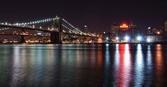 Pier 17 #1 (LilFr38) Tags: newyorkcity usa water night reflections lights eau manhattan bridges financialdistrict eastriver nuit reflets ponts lumires pier17 nikond80 lilfr38 nikkor18200f35dxvr specialistinterpol
