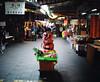 Market fruit seller, Danshui, Taipei, Taiwan (deepstoat) Tags: colour 120 film mediumformat taiwan rangefinder danshui mamiya7ii kodakportra autaut deepstoat