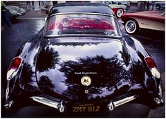 1957 Corvette in the rain (hz536n/George Thomas) Tags: summer black chevrolet film wet rain lab ae1 michigan january scan chevy sloan canonae1 corvette ektachrome flint 2010 smrgsbord cs3 labcolor dimagescandualiv p1f1 hz536n