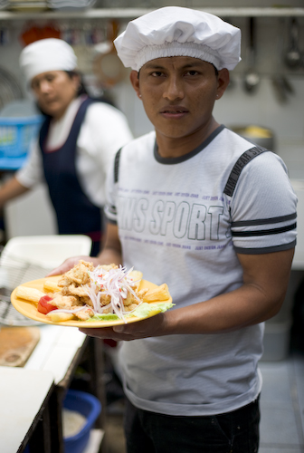 Chicharron de Pescado, and chef showing me the final product in the kitchen, Huanchaco Peru.