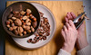 41/365 - The wife crackin' nuts. (Micah Taylor) Tags: shells yellow ceramic hands walnut nuts bowl crack cracker pecan chesnut project365