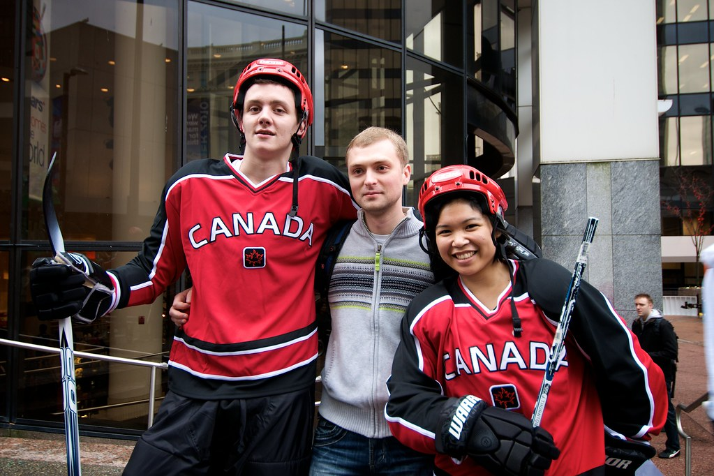 Hockey Players Pose With Dude
