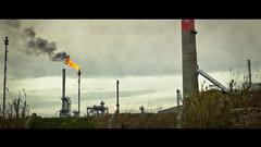 On Fire ([Schmitzoide]) Tags: chimney sky dark fire smoke dirty oil cinematic refinery atmophere