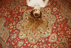 (EYLUL ASLAN) Tags: red girl yellow hair skin flash pale onthefloor turkishcarpet