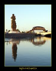 reflection -balad (Jeddah Vision) Tags: bridge sculpture lake water buildings landscape arab corniche saudi arabia jeddah balad saudiarabia woodenbridge citycentre jedda jidda jiddah babmakkah jeddahpanorama hailstreet