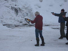 Guys shooting a snowbank