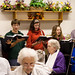 Byron Peachey, campus pastor, sings with students for residents at the retirement community.