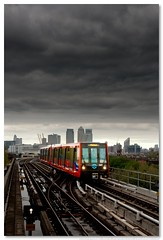 Docklands Light Rain (Phillippe Photography) Tags: cloud london train dark grey moody may environment docklands lightrail canarywharf dlr 2010 millenniumdome 1635mm canon400d