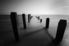 Last Stand (Drift Imagery) Tags: ocean longexposure light sea sky blackandwhite reflection beach water contrast sunrise dawn coast movement exposure norfolk overstrand neutraldensity seadefense