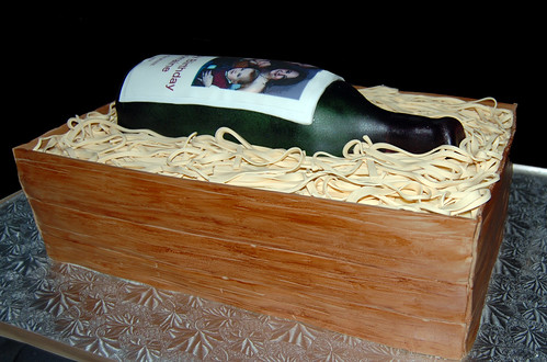 Wine bottle in a wooden crate birthday cake side view