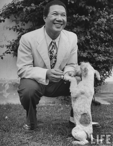 Hongkong 1948 - Refugee Emperor Bao Dai of Annam shaking hands with dog.