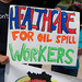 'Healthcare for Oil Spill Workers' sign among many at the 3-State Press Rally for Fisherfolk in Biloxi, MIssissippi - TEDx Oil Spill Expedition