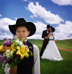 cowboy up (manyfires) Tags: flowers wedding portrait sky film clouds mediumformat square groom bride marriage hasselblad wyoming cowboyhat hasselblad500cm redroad 500px gettyimagespick