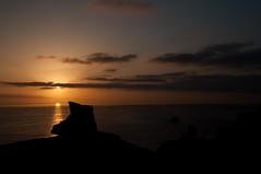 Finisterre sunset (hunter of moments) Tags: travel sunset shadow sea sky people orange sun color sol way landscape mar nikon camino paisaje puestadesol silueta ocaso caminodesantiago finisterre fisterra d5000