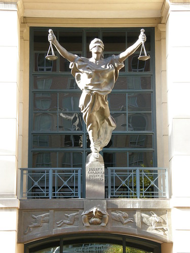 Lady Justice statue of a woman holding two scales