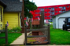RED, WHITE, & BLUE--YELLOW & GREEN TOO (akahawkeyefan) Tags: flags house apartments desmoines davemeyer