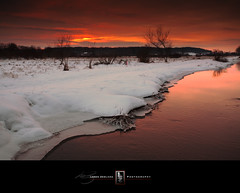 This Time Next Year (Loren Zemlicka) Tags: winter sunset sky orange snow ice nature water wisconsin river landscape photography photo midwest stream december image picture bank newyear explore madison ripples 2009 canonef1740mmf4lusm canoneos5d flickrexplore flickrfrontpage ninesprings lorenzemlicka